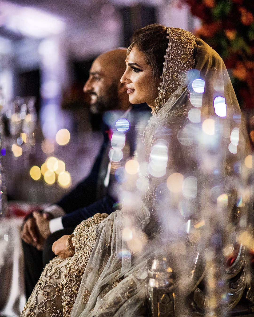 Portrait of an Indian couple seating with bokeh effect on the side
