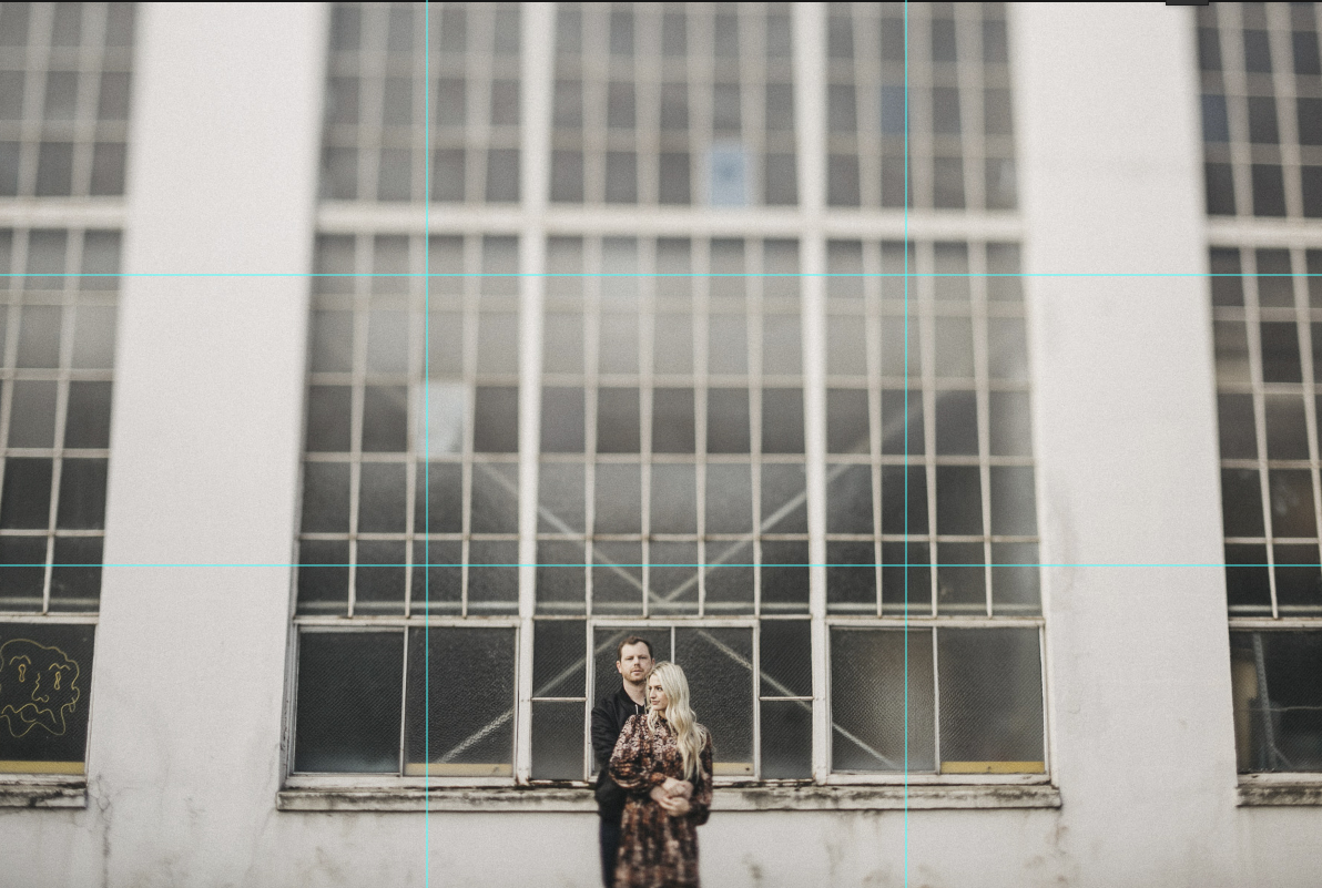 A 3 by 3 camera grid is visible on the image where a couple holds each other while standing in front of a wall