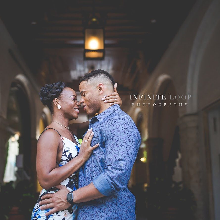 Portrait of a couple posing for an indoor engagement session