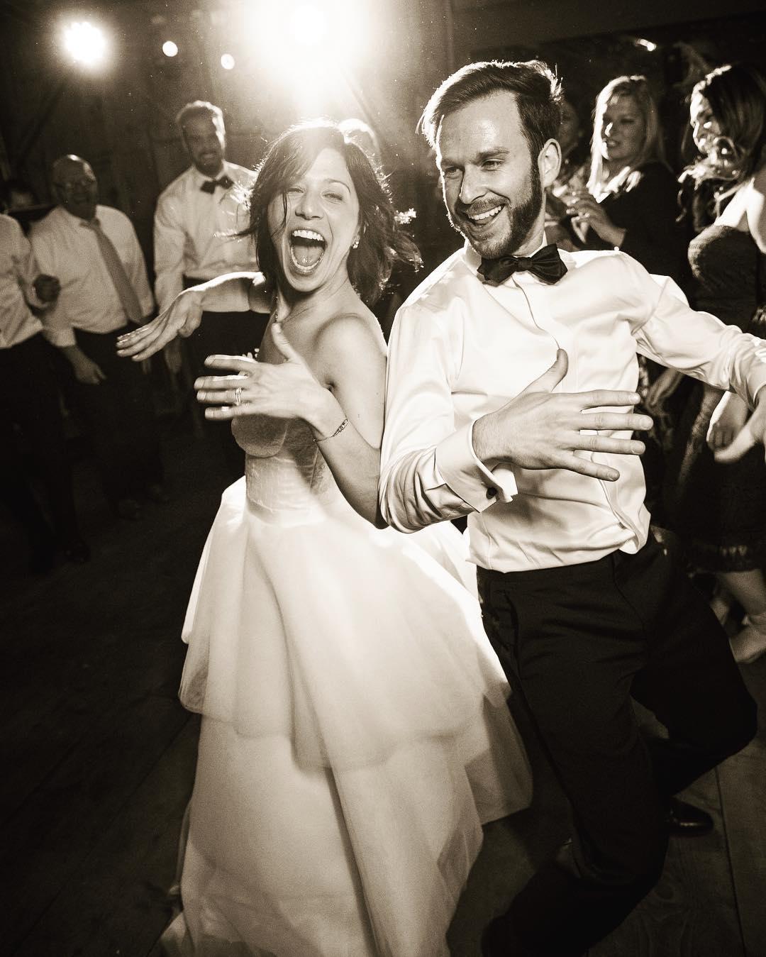 A bride and groom dancing during the open dance floor