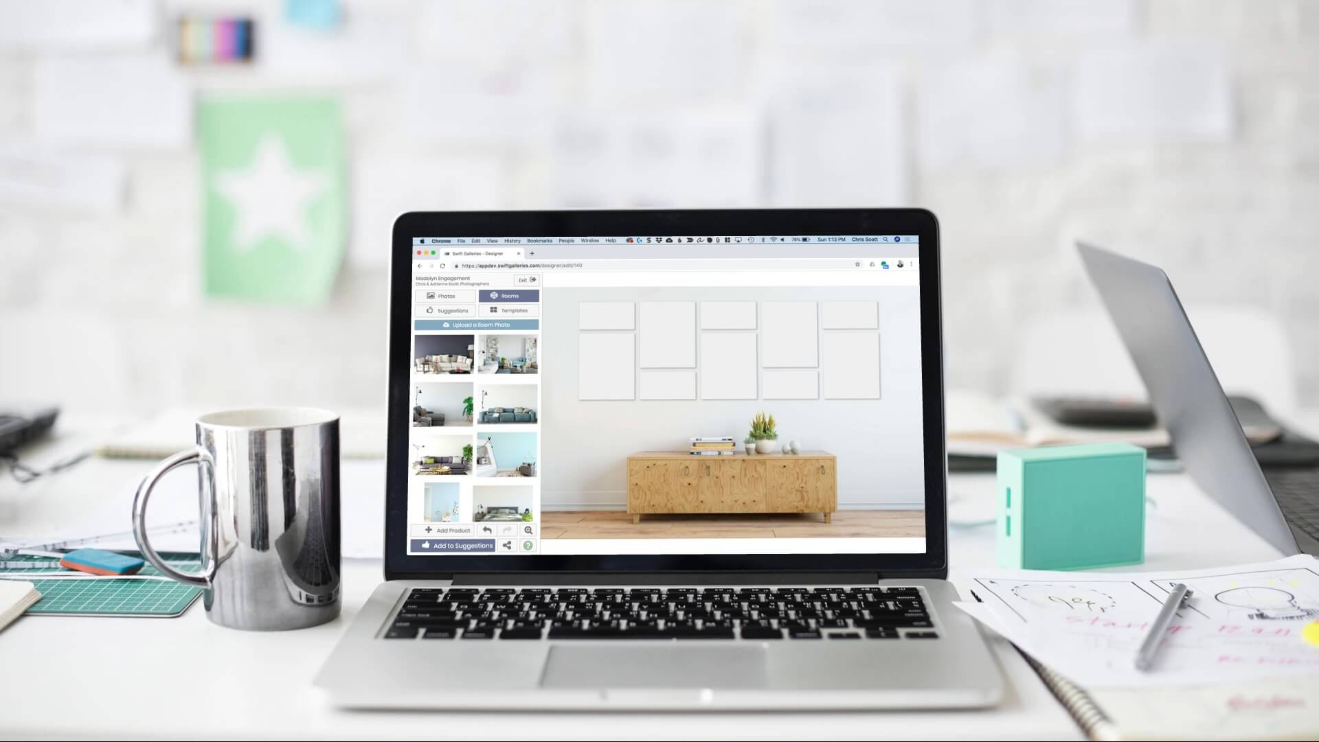 Placed on a white colored table, a laptop displays wall art templates