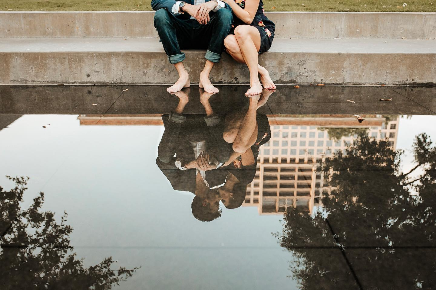 Reflection of a couple kissing while sitting at the stairs